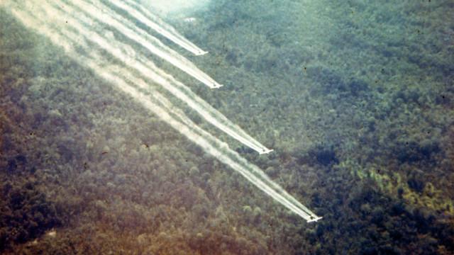 Four-ship formation on a defoliation spray run. (U.S. Air Force photo)